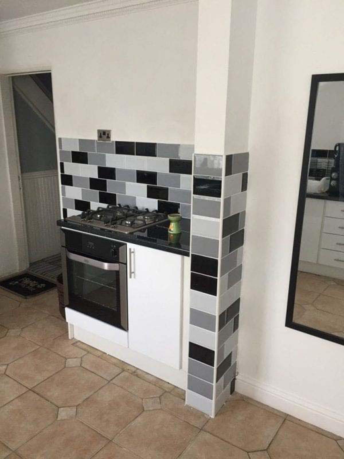 Jane Brady's White Gloss Kitchen With Grey Tiles