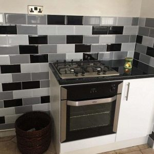 Jane Brady's White Gloss Kitchen With Grey Tiles